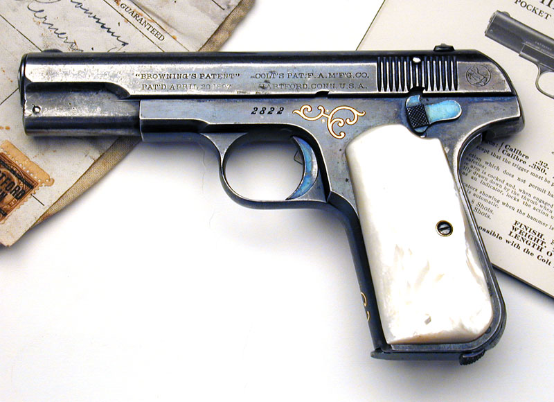 Colt 1903 Pocket Hammerless .32 ACP Factory Engraved & Inscribed, Gold Inlaid with Mother of Pearl stocks.